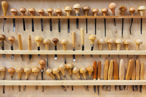 wood carving tools on a tool rack