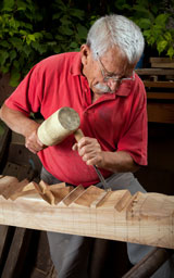 wood-carver using wood carving tools