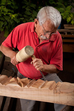 woodcarver using a mallet and a gouge